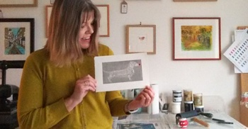 Jane Duke holding her Comic Relief Limited Edition print