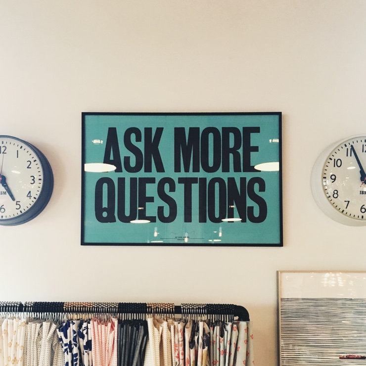 Sign saying 'Ask More Questions'