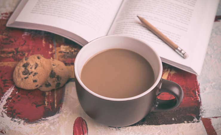 Coffee, cookies, book with a pencil