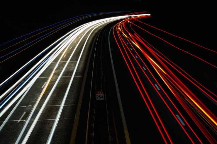 Long exposure photograph of car travelling at night time