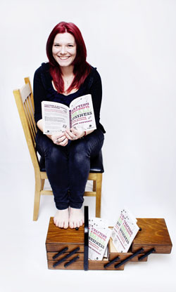Joanne Dewberry sitting with book