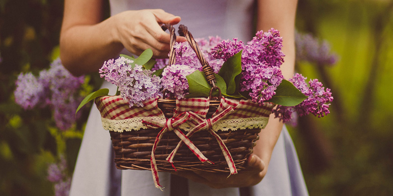 woman holding a basket of flowers