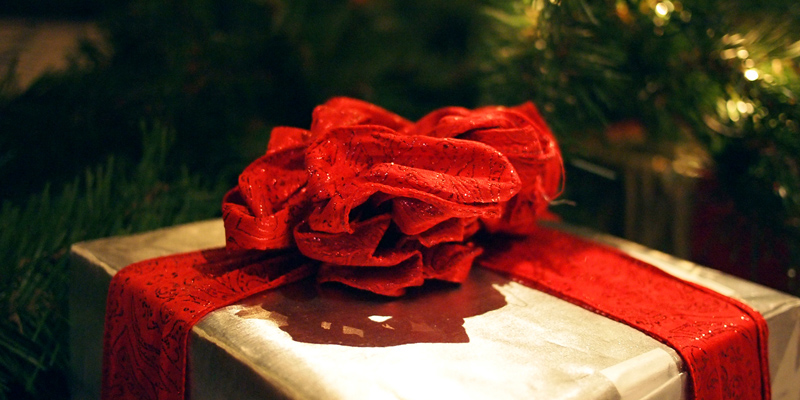 6 Easy Ways To Get Ready For Christmas image of present under christmas tree