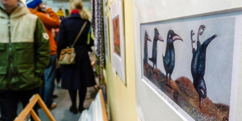image of crow painting and people walking around the exhibition