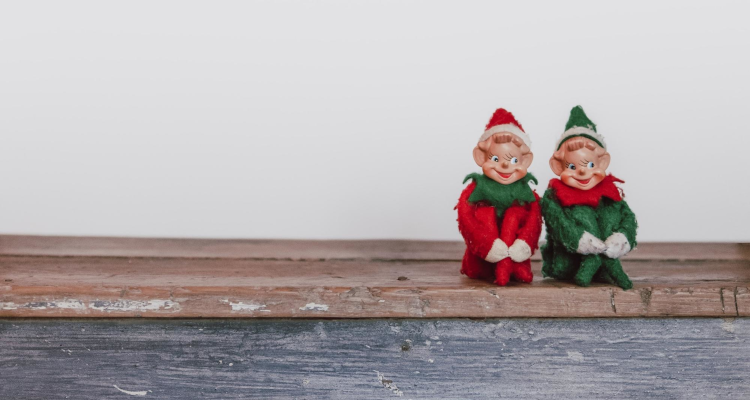 Two elves sitting on a shelf