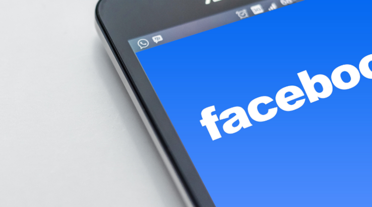 Facebook's brand on a phone screen