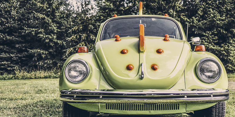 Photography by Ryan McGuire from gratisography.com of a green and orange car in a field