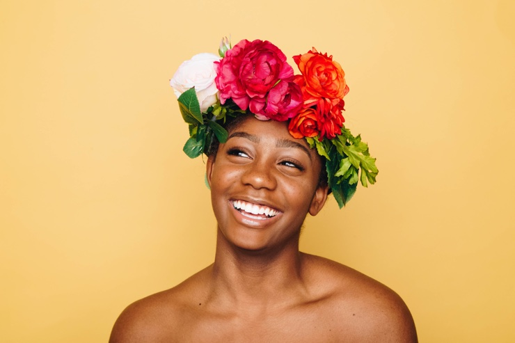 happy woman with flowers round her head