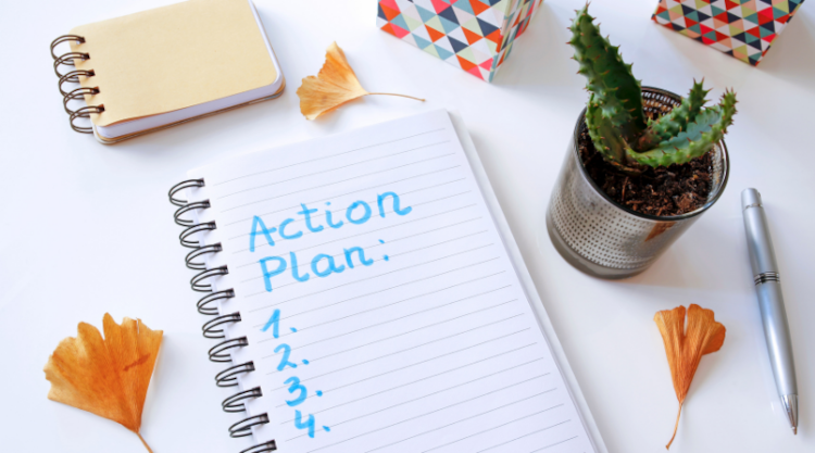A blank 4 step action plan in a notebook