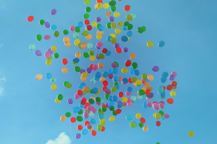 Multicoloured balloons floating into the sky