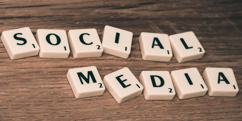 Scrabble words spelling out Social Media for 8 User Experience Tips to make your site delightful blog
