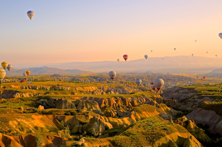 Hot air balloons over beautiful landscape in the evening sun