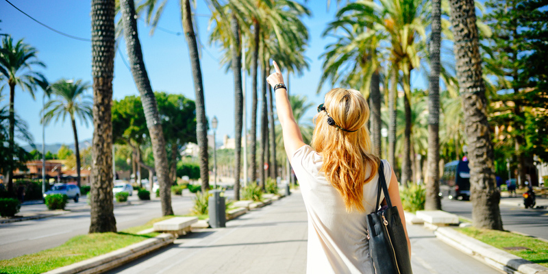 Stock image from stokpic.com of a lovely summer scene of palm trees and a woman