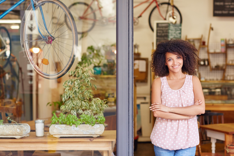 Small Business Owner in Bike Shop Window