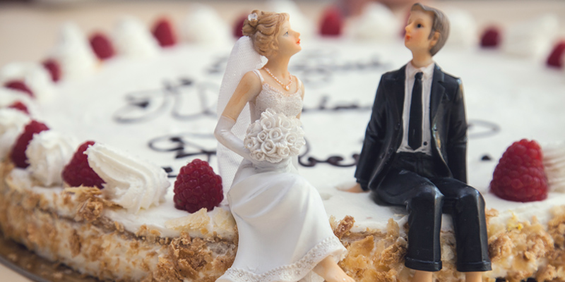 Wedding cake with bride and groom figures sitting on top